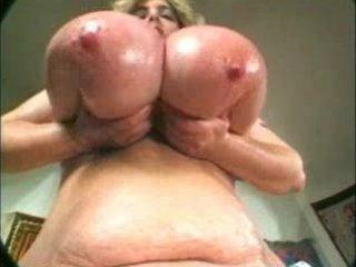 Plump granny with fatty boobs