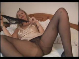 Busty mature blonde in pantyhose takes them off