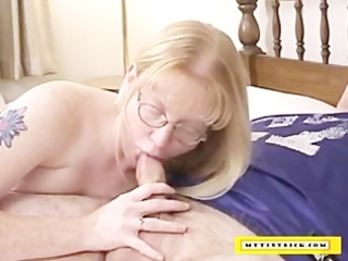 aged blond engulfing on a petite cock