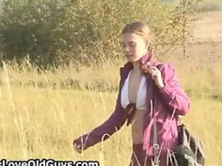 legal age teenager gal on a hike outdoor disrobes