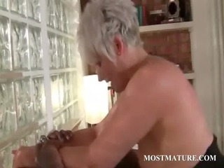 Arroused cougar enjoys riding penis