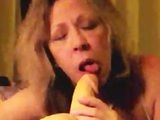 lewd older wife sucks a squirting sex-toy slowly