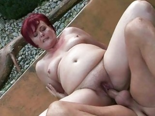 plump grandma enjoying hard sex