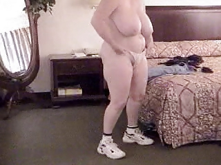 mature jan getting clothed