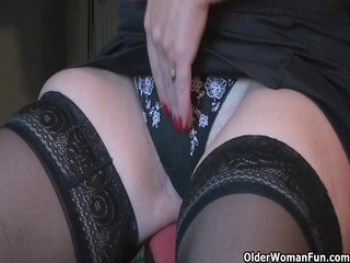Granny Fun plays with her vibrator collection