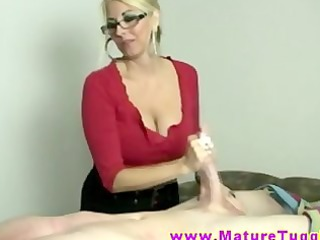 blond mother i massages knob with her hands