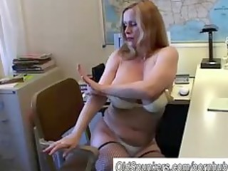 breasty cougar in fishnet nylons