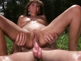 granny enjoys hot sex with boy outdoor