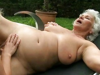 busty grandma and youthful hotty have sex outdoor