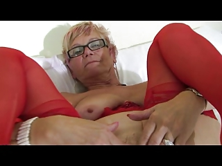 granny in glasses and red lingerie and stockings